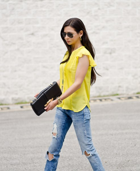 yellow blouse with cap sleeves and blue boyfriend jeans