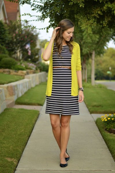 yellow cardigan with black and white striped midi dress