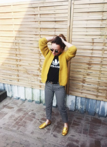 yellow cardigan with black printed T-shirt and dotted trousers