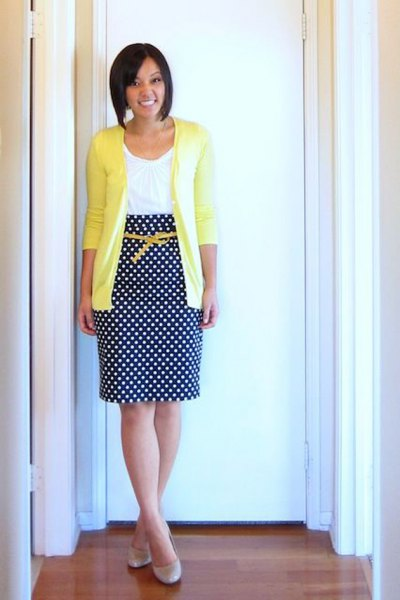 yellow cardigan with white vest and dotted midi skirt