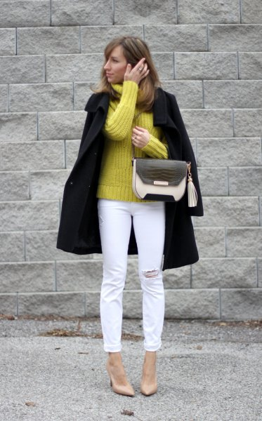 yellow chunky knitted sweater black wool coat