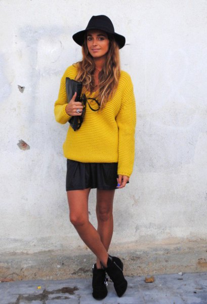 yellow, chunky sweater with mini skirt and black felt hat