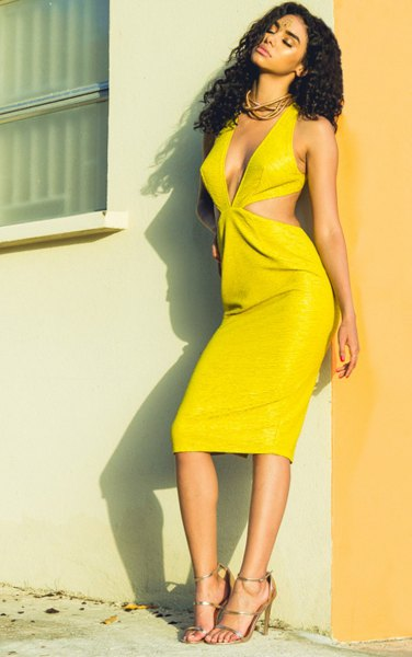 yellow midi dress with deep V-neckline and straps and open toe heels