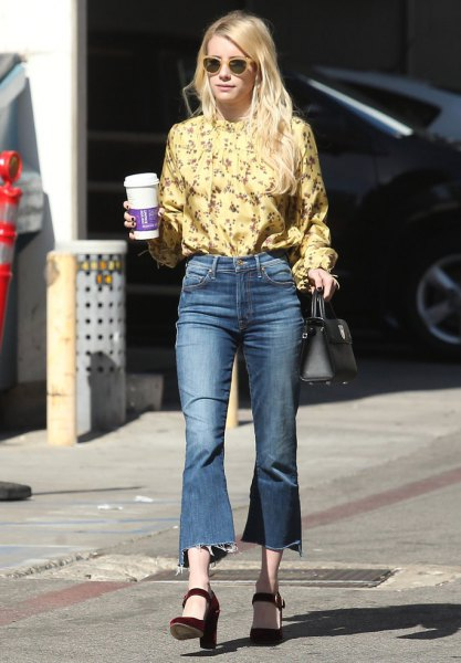 yellow blouse with a floral pattern and flared, cropped jeans
