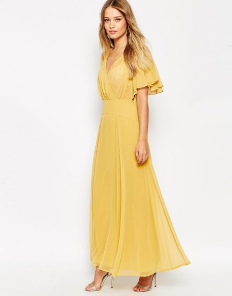 yellow wrap dress made of chiffon with fluttering sleeves