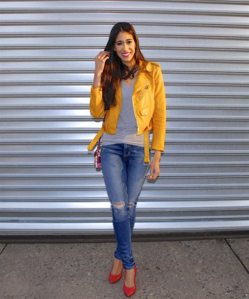 yellow jacket gray vest top blue ripped jeans