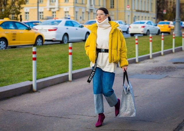 yellow jacket with black turtleneck and wide leg jeans