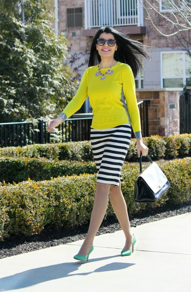 yellow long sleeved t-shirt striped knee length skirt