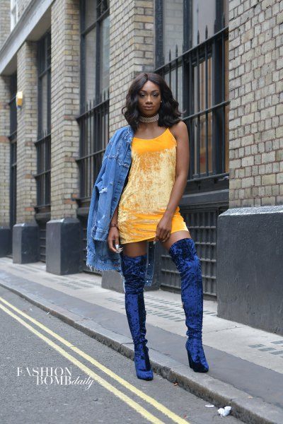 yellow mini shift dress with denim jacket and blue velvet boots