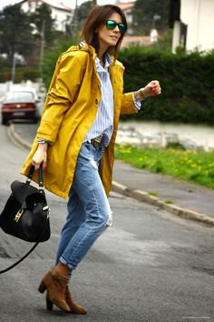 yellow oversized rain jacket with boyfriend shirt and ripped jeans