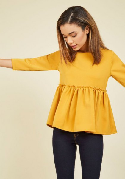 yellow peplum blouse with dark blue skinny jeans
