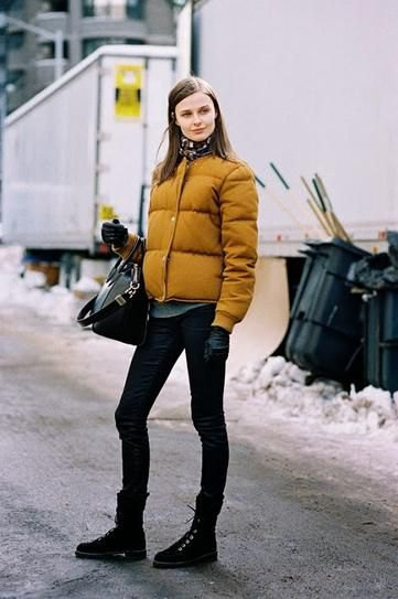 yellow puffer jacket with gray shirt with buttons and black skinny jeans