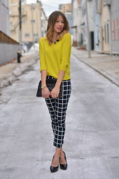 yellow sweater with black and white, narrow checked trousers