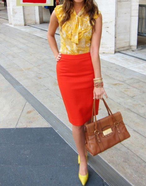 sleeveless chiffon blouse with a yellow bow and an orange pencil skirt