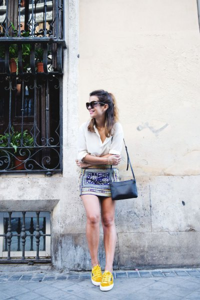 yellow running shoes with white blouse and tribal skirt
