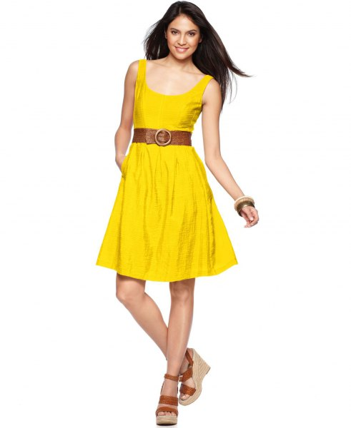 yellow knee-length dress with belt and belt