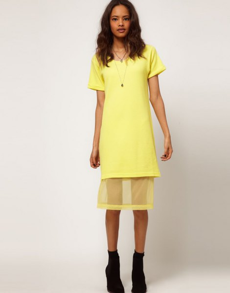 yellow shirt dress with semi-transparent mesh overlay