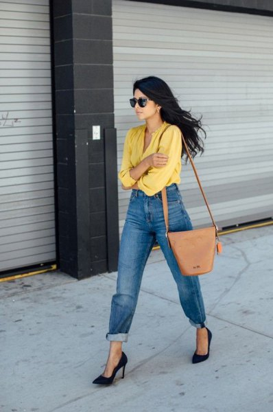 yellow shirt with tied washed mom jeans