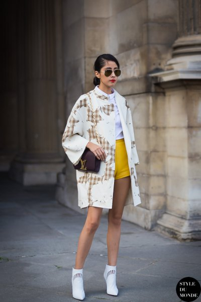 yellow shorts white trench coat