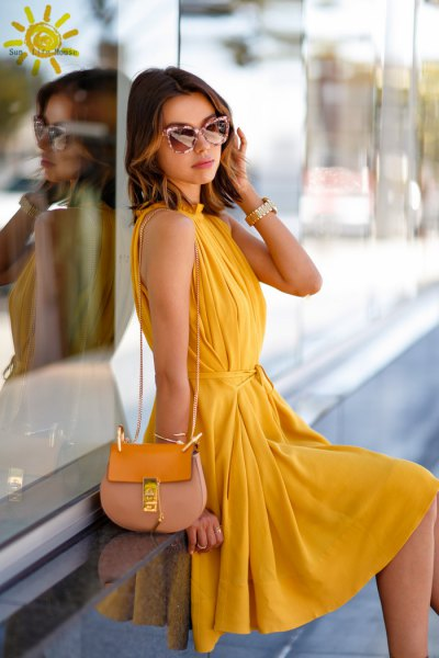yellow sleeveless, pleated midi pleated dress with pink wallet