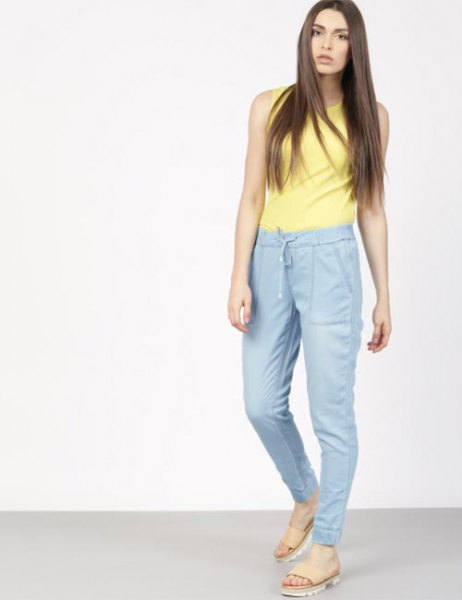 yellow sleeveless top with blue high-waisted jogger pants
