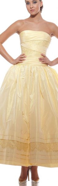yellow strapless fit and shiny maxi dress