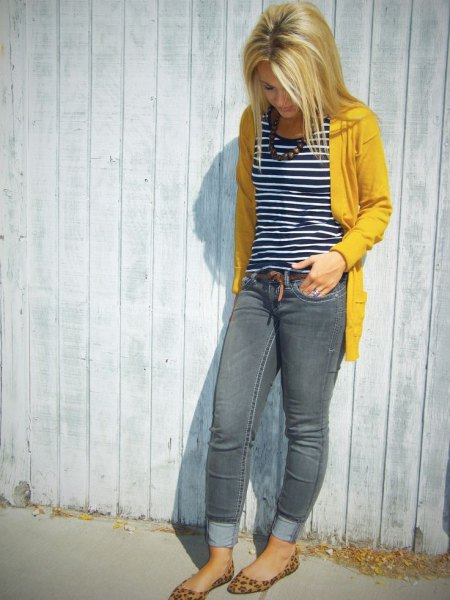 yellow pullover jacket with black and white striped tank top