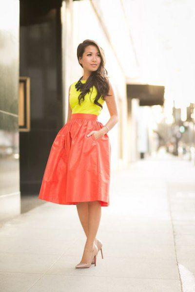 yellow top high waisted red skirt