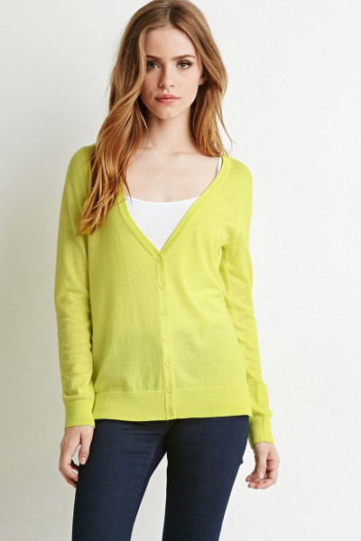 yellow cardigan with V-neck and white vest