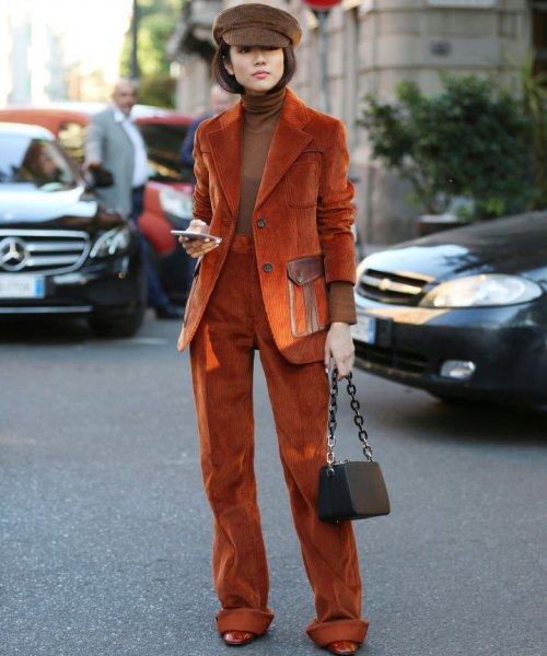 yellowish-brown blazer with matching trousers and green sweater